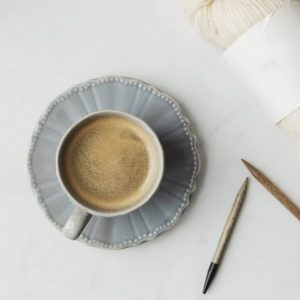 coffee-in-a-tea-cup-and-wool-for-knitting